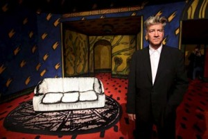 "David Lynch poses with his work ""Untitled"" at the Max Ernst Museum. Photo: EFE/Oliver Berg."