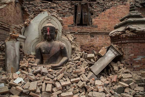 Earthquake damage at a temple in the historic city of Bhaktapur, Nepal, a Unesco World Heritage Site, photograph by Omar Havana/Getty Images