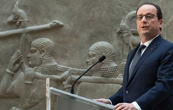 French president François Hollande at the Louvre, alongside its Assyrian antiquities, announcing that the museum would support colleagues in Iraq. © AP Photo