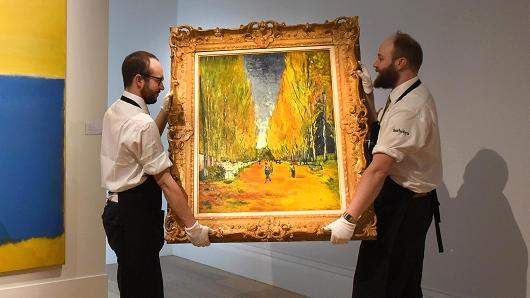 Getty Images Gallery technicians carry Vincent Van Gogh's 'L'Allee des Alyscamps', at Sotheby's in London